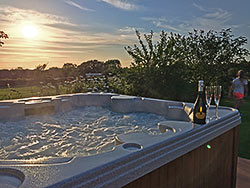 relax with a drink in the hot tub with views of Lleyn peninsula